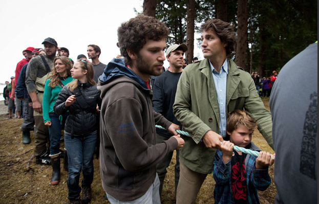 Liberal leader Justin Trudeau and his son Xavier Trudeau help raise the Gwaii Haanas legacy totem pole in Windy Bay, B.C., on Lyell Island in Haida Gwaii on Thursday, August 15, 2013. The 13-metre totem is the first monumental pole to be raised in the area in 130 years. It was carved to celebrate the 20th anniversary of the Gwaii Haanas Agreement, a document that allows the government of Canada and the Haida Nation to co-manage and protect the region. Darryl Dick, The Canadian Press